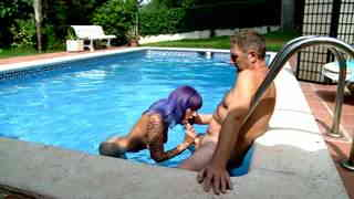 Tattooed babe fucking at the pool